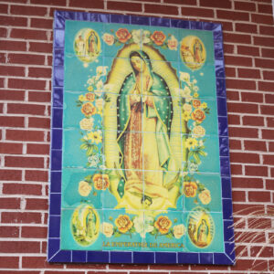 A tile painting of Our Lady Of Guadalupe on exterior of Sacred Heart Catholic Church in Springfield MO