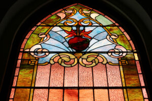 Stained glass window featuring the Sacred Heart of Jesus Christ in Sacred Heart Catholic Church in Springfield MO