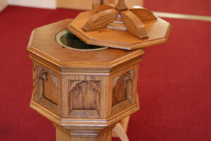 Wooden octagonal Baptismal font Sacred Heart Catholic Church in Springfield MO